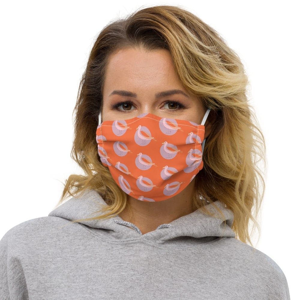 Woman's washable face mask in orange print with seagulls