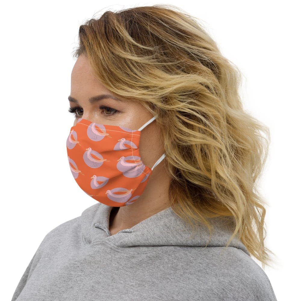 Side view of woman wearing fun and bright face mask. Washable.